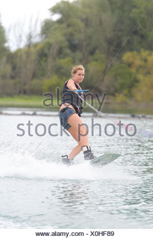 athlete enjoys wakeboarding on the river - Stock Photo