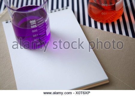 Laboratory Glassware With Notepad - Stock Photo