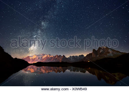 Europe, France, Haute Savoie, Chamonix Mont Blanc - Cheserys lake and the Mont Blanc Massif at a starry Night - Stock Photo