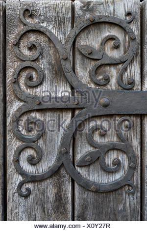 Hand-forged iron works on a wooden door, Isny im Allgäu, Allgäu, Upper Swabia, Baden-Württemberg, Germany - Stock Photo