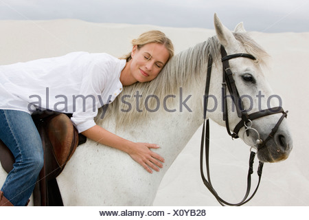 Horse with girl rider - Stock Photo