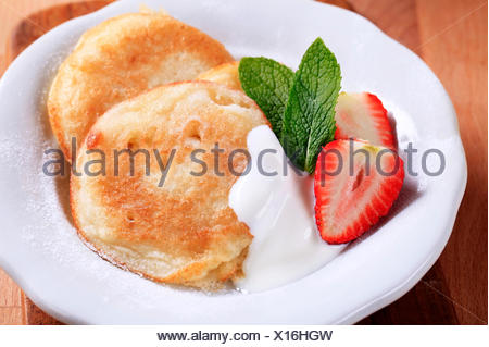 food aliment sweet closeup small tiny little short plate strawberry nobody pancakes fried cooked dessert snack breakfeast - Stock Photo