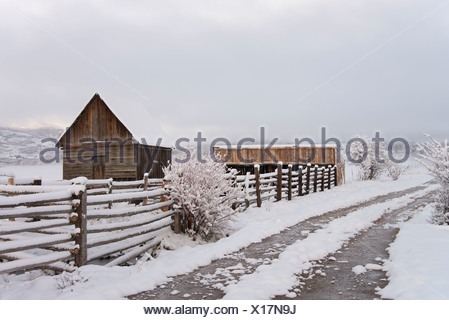 A barn and paddock with fencing in the snow in the Green River Lakes area. - Stock Photo