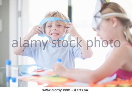 Children's mask making party - Stock Photo