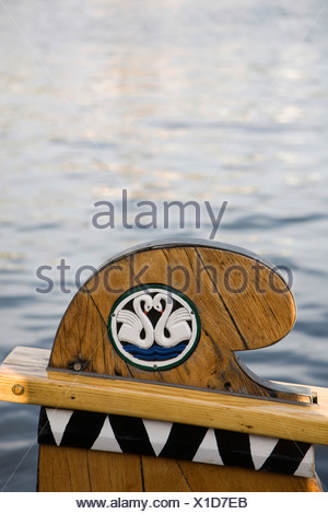 Two white swans forming a heart shape decorate a wooden bow at the Flensburg Nautics sailing festival, Flensburg - Stock Photo