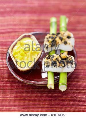 Halibut with green tea crust and lemon grass sauce - Stock Photo
