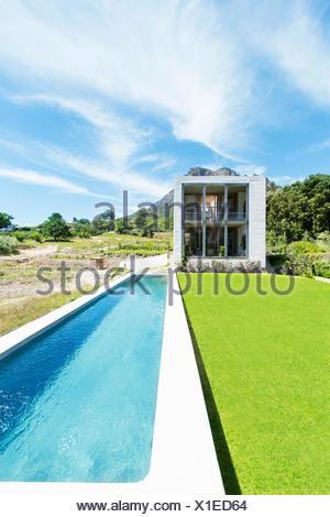 Modern swimming pool under blue sky - Stock Photo
