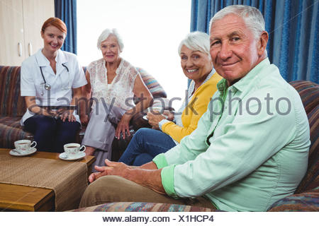Portrait of smiling retired person looking at the camera - Stock Photo