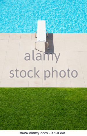 Diving board over pool - Stock Photo