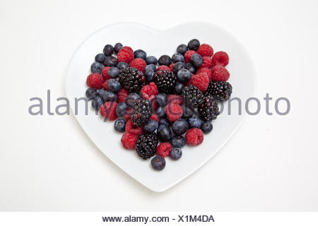 Mixed Berries on Heart Shaped Plate - Stock Photo