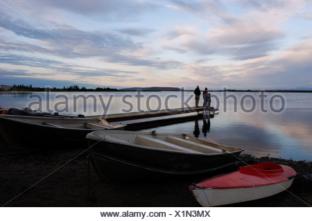 Woman and two children on a jetty in Laugarvatn, Iceland, Europe - Stock Photo