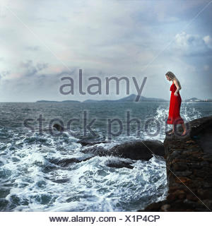 Woman standing on edge of cliffs, Koh Samui, Thailand - Stock Photo