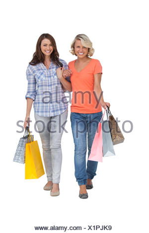 Two cheerful friends with shopping bags - Stock Photo