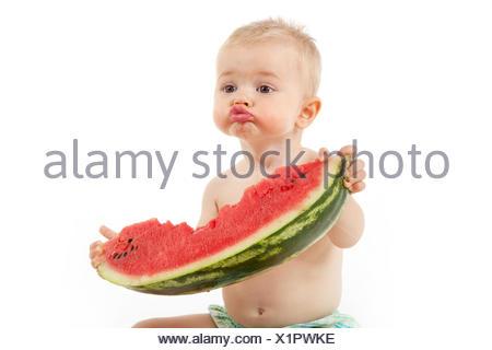 Boy eating slice of watermelon - Stock Photo