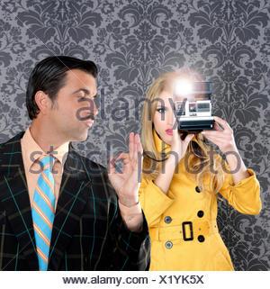 geek mustache man reporter fashion girl photo shoot - Stock Photo
