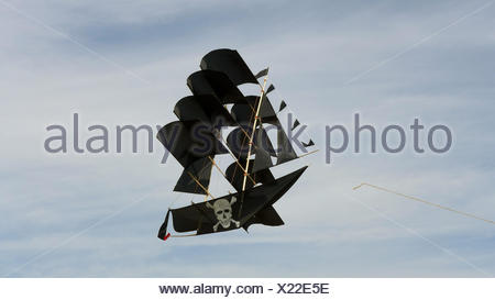 kite in shape of a pirate ship in the sky - Stock Photo