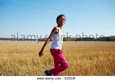 Sweden, Vastra Gotaland, Gullspang, Runnas, Boy (8-9) running in field - Stock Photo