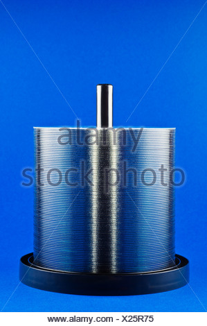 Studio shot of stack of CDs on spindle - Stock Photo