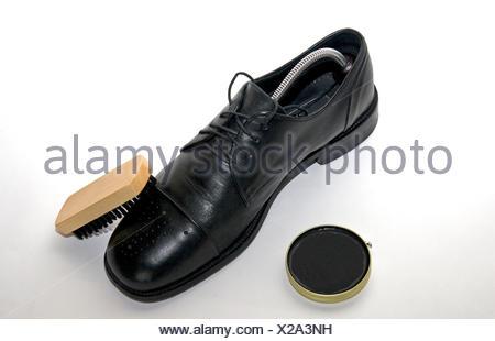 leather brush furbish clean shoepolish shoe black swarthy jetblack deep black - Stock Photo