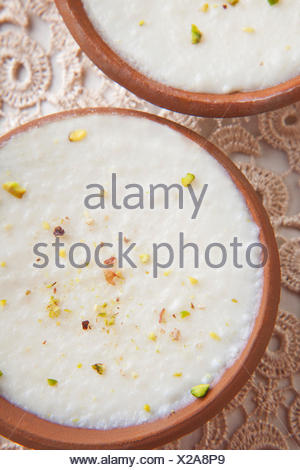 Directly above shot of phirni bowls on table - Stock Photo