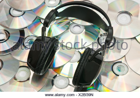 black headphones and lots of CDs - Stock Photo
