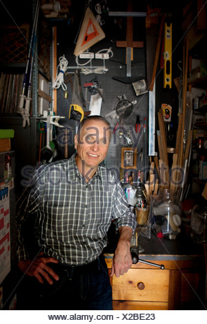 Senior man in workshop, portrait - Stock Photo