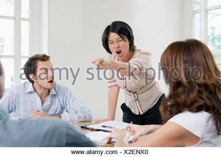 Female shouting in a meeting - Stock Photo