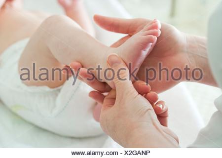 Baby's foot - Stock Photo