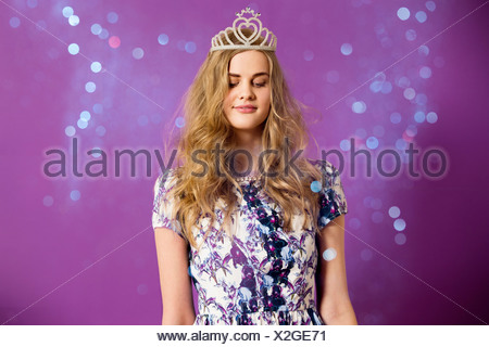 Young woman wearing tiara with glitter - Stock Photo