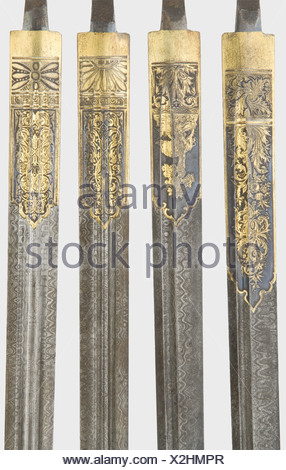 Four Damascus blades for hunting hangers, Max Dinger, Solingen, end of the 19th century Double-edged blades with ridged points and differing types of fullers. At the bases various decorative etchings with ornamental and hunting motifs and well-preserved gilding against blued backgrounds. At the tapered tang each is marked 'DAMAST' and 'MD' for Max Dinger. Never mounted blades with finely perforated tangs, presumably from a pattern board. Lengths without tangs 47.5 to 49 cm. historic, historical, 19th century, double-edged hunting knife, thrusting, thrustings, w, Additional-Rights-Clearances-NA - Stock Photo