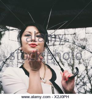 Woman with hand kiss - Stock Photo