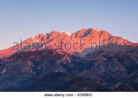 A view of the Presolana at sunset without snow from Monte Falecchio, Songavazzo, Val Seriana, Bergamo district, Lombardy, Italy. - Stock Photo