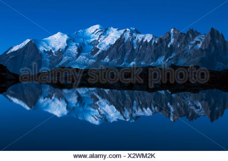 Europe, France, Haute Savoie, Chamonix Mont Blanc - Cheserys lake and the Mont Blanc Massif at blue hour - Stock Photo