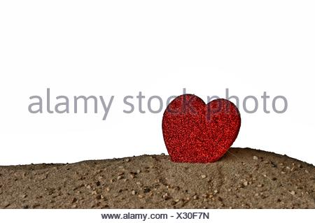 Heart standing in the sand - Performer - Stock Photo