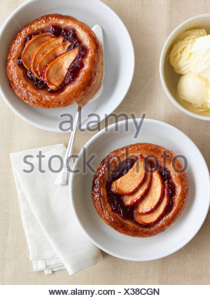 Apple and redcurrant tartlets - Stock Photo