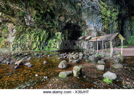 Covered bridge leading into the partly flooded with water Smoo Cave limestone cave, Durness, Northern Highlands - Stock Photo