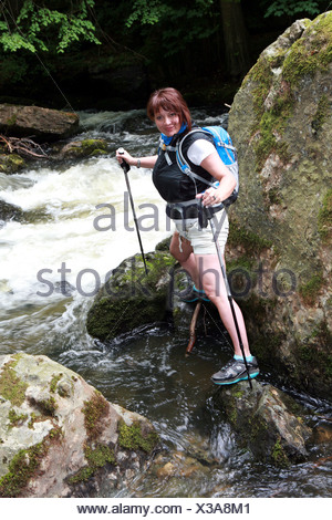 female walker with hiking sticks - Stock Photo