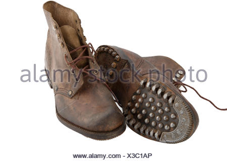 old military shoes on the white background - Stock Photo