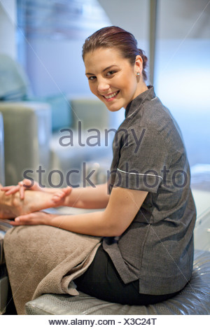 Portrait of masseur in spa treatment room - Stock Photo