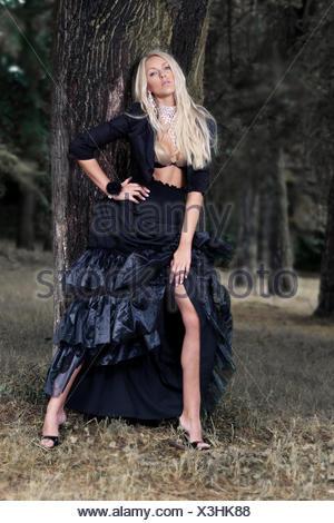 blonde in black dress - Stock Photo