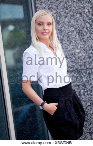 young successful businesswoman in the summer outdoors - Stock Photo