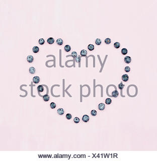 Blueberry Heart on pink background - Stock Photo
