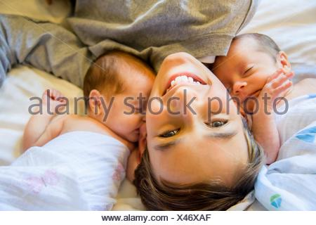 Big brother with twin baby sister and brother - Stock Photo