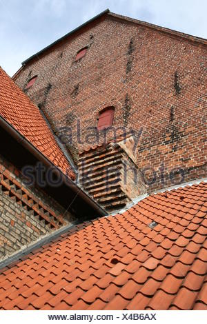 stone wall crannies flap metal fittings rooftop blue wood brick opening - Stock Photo