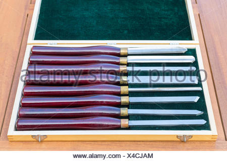 Set of wood turning chisels in wooden box - Stock Photo