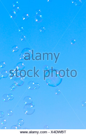 Bubble, Blister, flight, sky, circle, ring, ease, air, rainbow colors, soap, soap bubble, soap bubbles, play, game, blow, fly bl - Stock Photo
