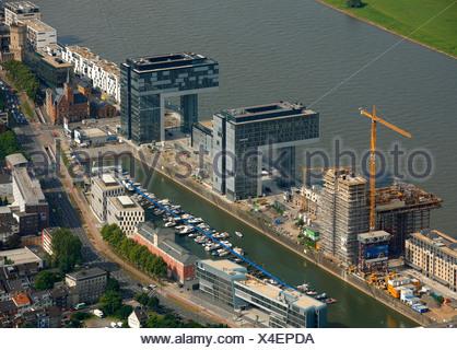 Aerial photograph, Kranhaus crane house construction site in Cologne Rheinauhafen, Pandion AG, Hafenquartier port district, Neu - Stock Photo
