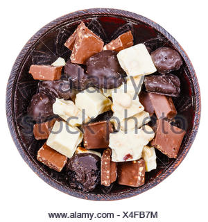 chocolate candies and broken bars in ceramic bowl isolated on white background - Stock Photo