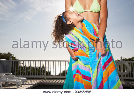 Woman and girl outdoors in summer in swimsuits - Stock Photo
