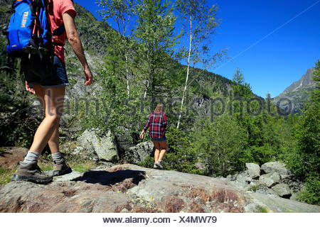 French alps. mont blanc massif. walkers on a path above the chamonix valley. france. - Stock Photo